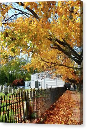 Graveyard In Autumn Canvas Print by Susan Savad