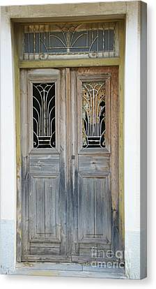 Greek Door With Wrought Iron Window Canvas Print by Maria Varnalis
