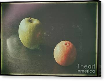 Green Apple And Tangerine Canvas Print by Jimmy Ostgard