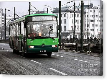 Green Bus On The Galata Canvas Print by John Rizzuto