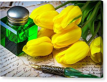 Green Ink Well And Yellow Tulips Canvas Print by Garry Gay