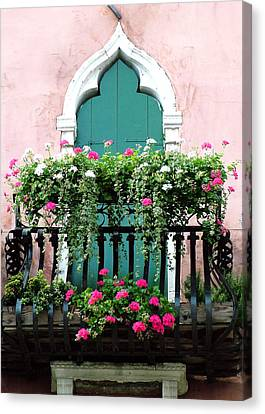 Canvas Print featuring the photograph Green Ornate Door With Geraniums by Donna Corless