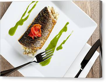 Grey Mullet With Watercress Sauce Presented On A Square White Plate With Cutlery And Napkin Canvas Print by Andy Smy