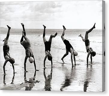Group Of People Doing Handstands On Beach (b&w) Canvas Print by Hulton Archive