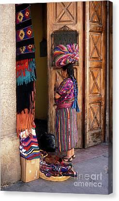 Guatemala Maya Textile Vendor Canvas Print by John  Mitchell