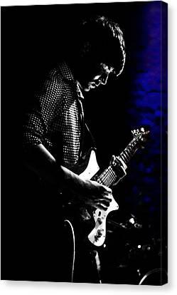 Guitar Man In Blue Canvas Print by Meirion Matthias