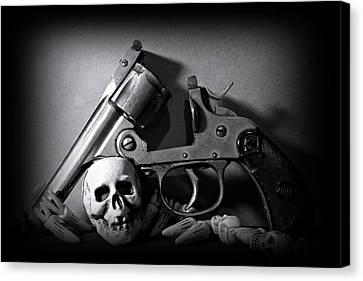 Gun And Skull Canvas Print by Scott Wyatt