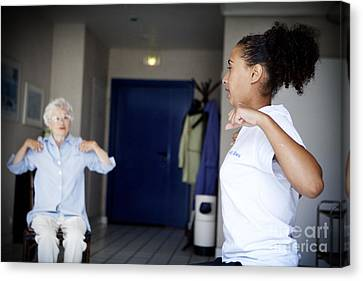Fitness Instructor Canvas Print - Gym Instructor With Elderly Person by Am�lie Benoist