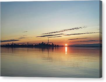 Half A Sunrise - Toronto Skyline From Across Silky Calm Lake Ontario Canvas Print by Georgia Mizuleva