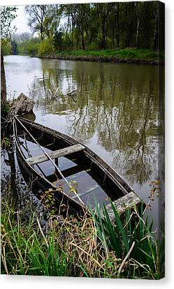 Half Sunken Rowboat Canvas Print by Marco Oliveira