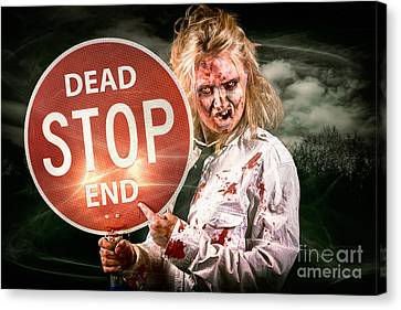 Halloween Portrait. Scary Zombie Holding Stop Sign Canvas Print by Jorgo Photography - Wall Art Gallery