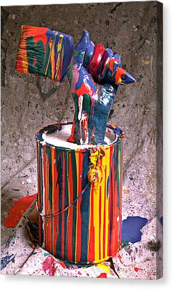 Hand Coming Out Of Paint Can Canvas Print by Garry Gay