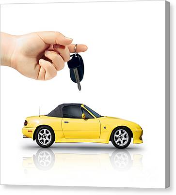 Hand Holding Key To Yellow Sports Car Canvas Print by Jorgo Photography - Wall Art Gallery