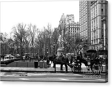 Handsome Cab At The Grand Army Plaza Canvas Print by John Rizzuto