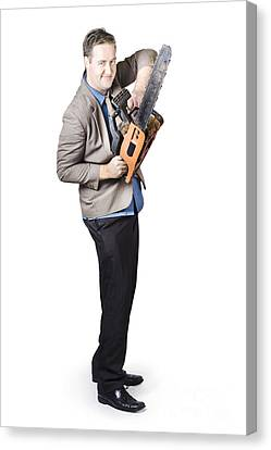 Happy Businessman Holding Chainsaw Canvas Print by Jorgo Photography - Wall Art Gallery