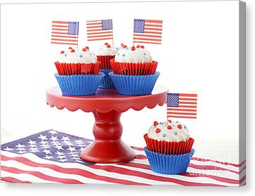 American Independance Canvas Print - Happy Fourth Of July Cupcakes On Red Stand by Milleflore Images