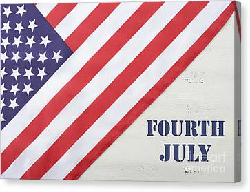 Happy Fourth Of July Usa Flag On White Wood Table Canvas Print by Milleflore Images