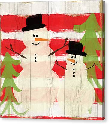 Happy Snowmen- Art By Linda Woods Canvas Print by Linda Woods