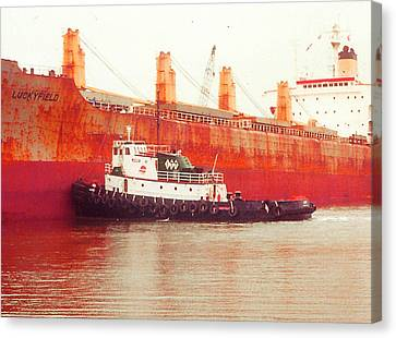 Harbor Tugboat Canvas Print by Fred Jinkins