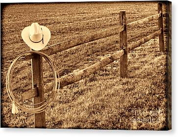 Hat And Lasso On Fence Canvas Print by American West Legend By Olivier Le Queinec