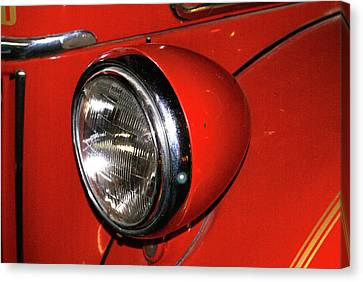 Headlamp On Red Firetruck Canvas Print by Douglas Barnett