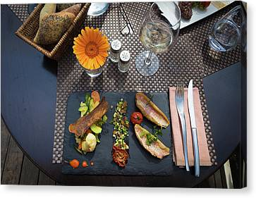 Canvas Print featuring the photograph Health Fish Dish Served At A French Restaurant by Semmick Photo