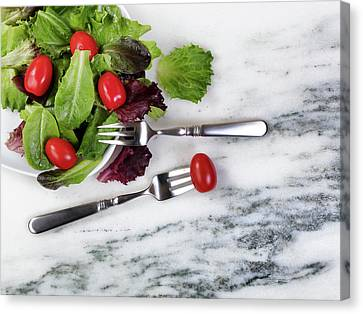 Healthy Organic Salad Flowing Out Of Plate On Natural Marble Tab Canvas Print