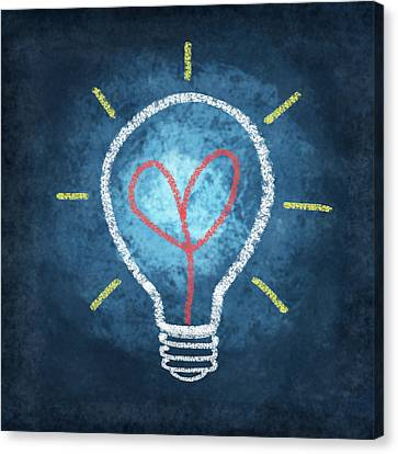 Heart In Light Bulb Canvas Print by Setsiri Silapasuwanchai