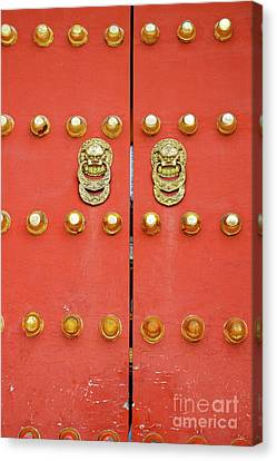 Heavy Ornate Door Knockers On A Gate Canvas Print by Sami Sarkis