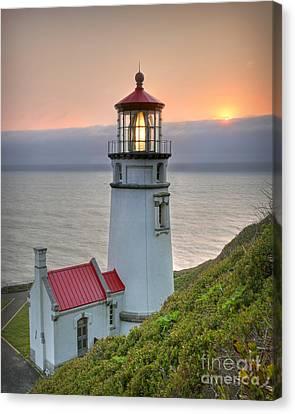 Heceta Lighthouse At Sunset Canvas Print by Martin Konopacki