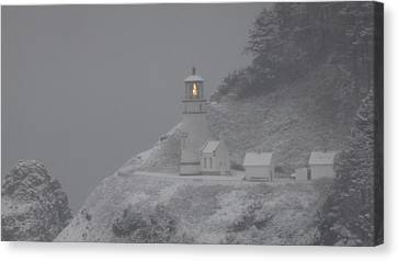 Heceta Lighthouse Snowstorm Canvas Print by Kenny Henson