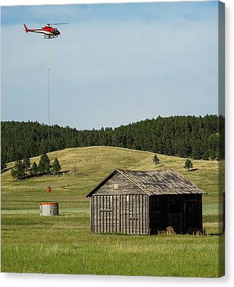 Helicopter Dips Water At Heliwell Canvas Print by Bill Gabbert