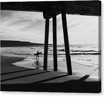 Canvas Print featuring the photograph Hermosa Surfer Under Pier by Michael Hope