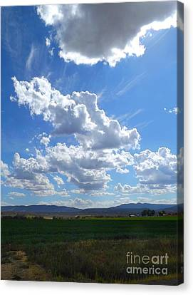 High Winds Chase The Rain Clouds Away Canvas Print by Annie Gibbons