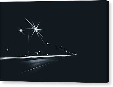 Highway In The City At Night With Streetlights And Long Exposure Canvas Print