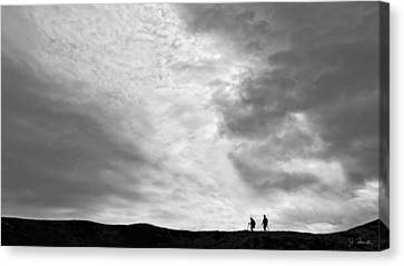 Canvas Print featuring the photograph Hikers Under The Clouds by Joe Bonita