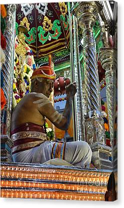 Hindu Man In Costume Sits On Vehicle For Festival Singapore  Canvas Print by Imran Ahmed