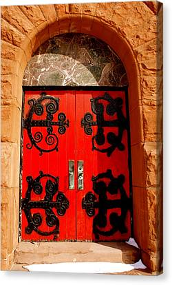 Historic Church Doors Canvas Print by Sonja Anderson