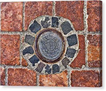 Canvas Print featuring the photograph Historic Pavement Detail With Hungarian Town Seal by Menega Sabidussi