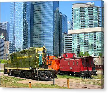 Historic Train Engine And Caboose At Roundhouse Park Toronto Canvas Print by John Malone