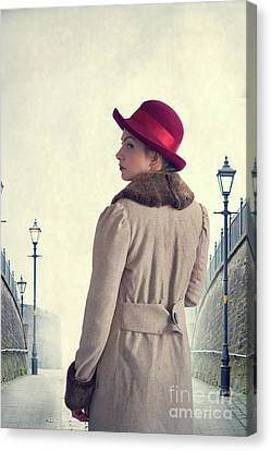 Canvas Print featuring the photograph Historical Woman In An Overcoat And Red Hat by Lee Avison