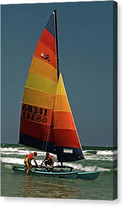 Hobie Cat In Surf Canvas Print by Sally Weigand