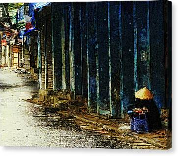 Homeless In Hanoi Canvas Print by Cameron Wood