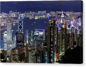 Hong Kong At Night Canvas Print by Leung Cho Pan