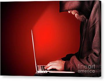 Hooded Computer Hacker Red Background Canvas Print