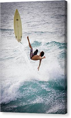 Hookipa Maui Flying Surfer Canvas Print by Denis Dore