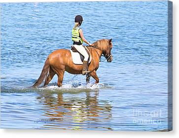 Horse And Rider In The Sea Canvas Print by Terri Waters