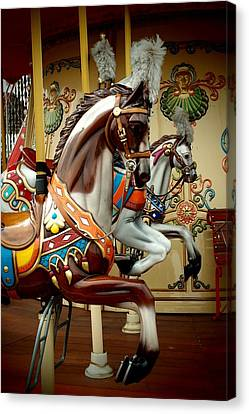 Horses Of The Carousel Canvas Print by Dora Hathazi Mendes