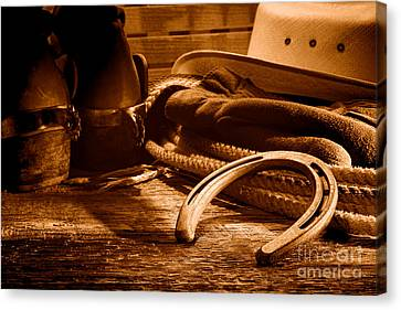 Horseshoe And Cowboy Gear - Sepia Canvas Print by Olivier Le Queinec