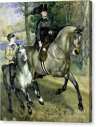 Horsewoman In The Bois De Boulogne Canvas Print by Pierre Auguste Renoir